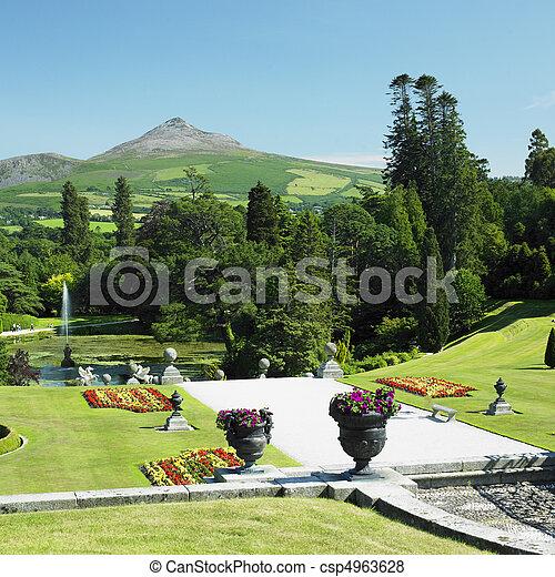 Powerscourt gardens, sugar loaf mountain at the background ...