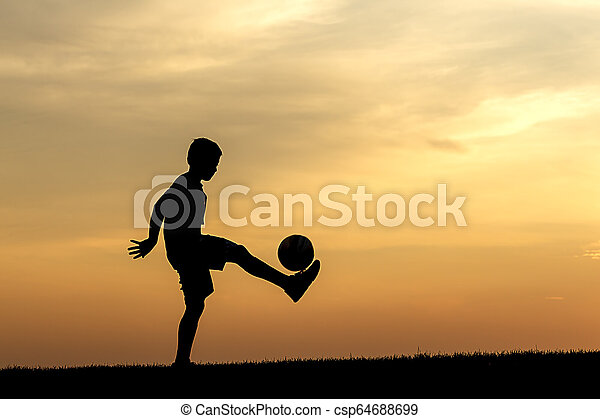 Practicing soccer at sunset. - csp64688699