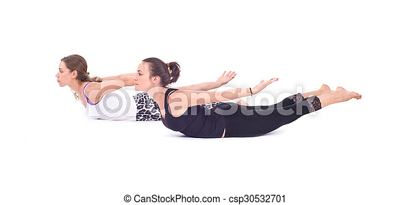 practicing yoga exercises in group two woman doing yoga