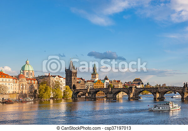 Prague, Czech Republic skyline with historic Charles Bridge and Vltava river - csp37197013
