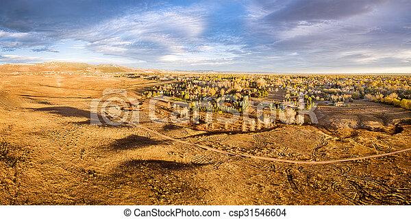 prairie at Colorado foothills - aerial panorama - csp31546604