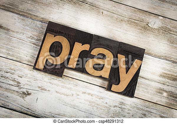 Pray Letterpress Word on Wooden Background - csp48291312