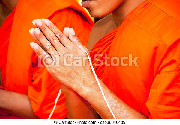 pray, Put the palms of the hands together in salute , monks, thailand - csp36040489