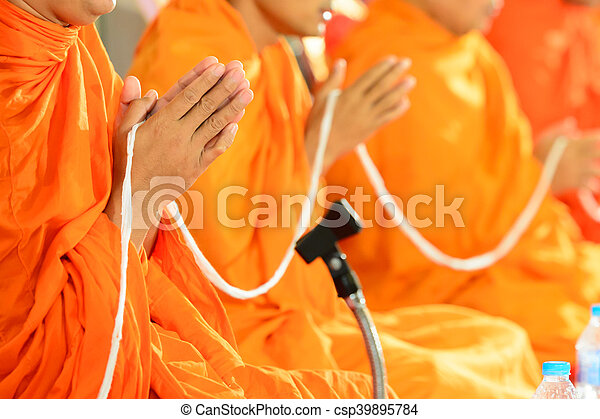 pray, Put the palms of the hands together in salute , monks, thailand - csp39895784