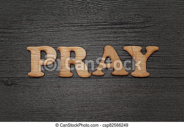 Pray words text, wooden alphabet lettering - csp82566249
