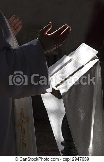Prayer in some catholic church - csp12947639