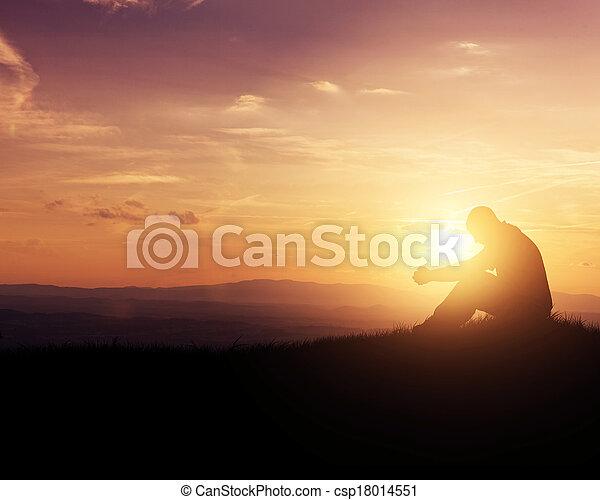 Praying at sunrise - csp18014551