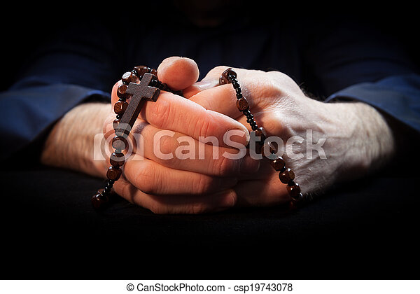 d3a14e378 Praying hands. Holding rosary beads and cross while praying.