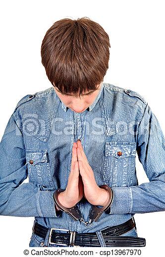 Praying Man in Handcuffs - csp13967970