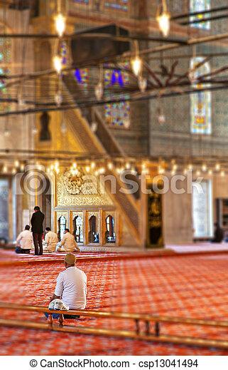 Praying muslims - csp13041494