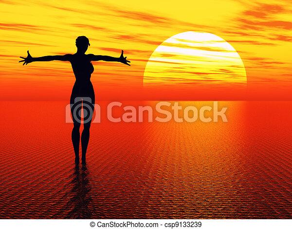Praying woman reaching for the sun - csp9133239