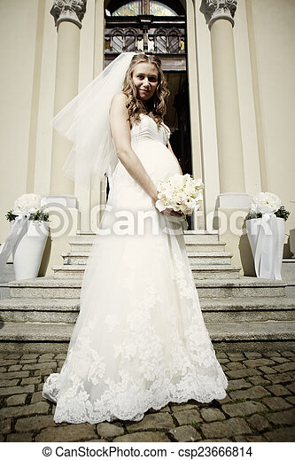 Pregnant bride in bridal gown. Nice young woman on wedding day ...