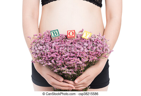 pregnant woman and alphabet blocks spelling BOY on white background - csp38215586