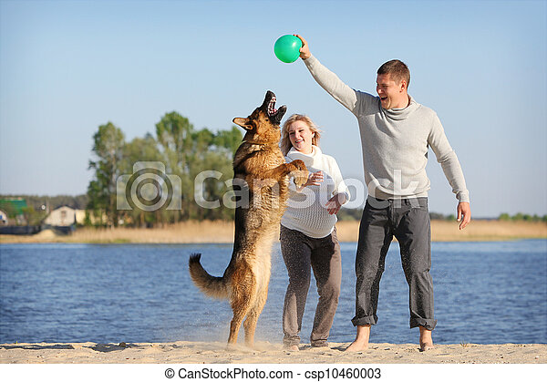 Pregnant woman and man with dog - csp10460003