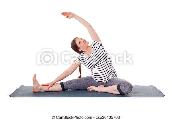 pregnant woman doing yoga asana parivrtta janu sirsasana