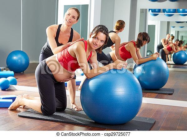 pregnant woman pilates fitball exercise - csp29725077