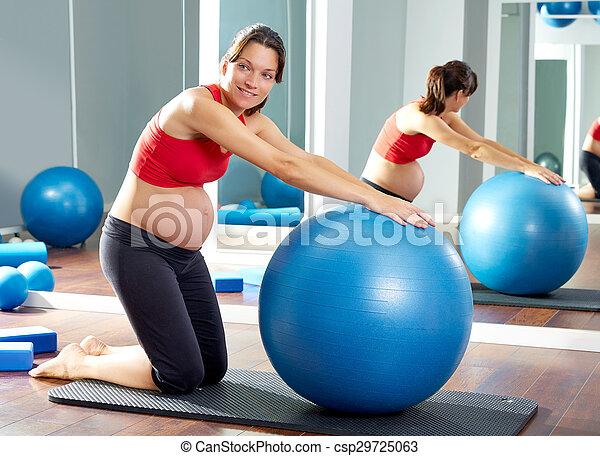 pregnant woman pilates fitball exercise - csp29725063