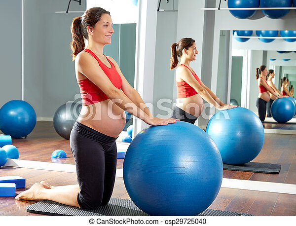 pregnant woman pilates fitball exercise - csp29725040