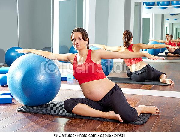 pregnant woman pilates mermaid fitball exercise - csp29724981