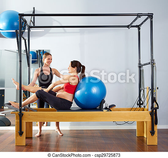 pregnant woman pilates reformer fitball exercise - csp29725873