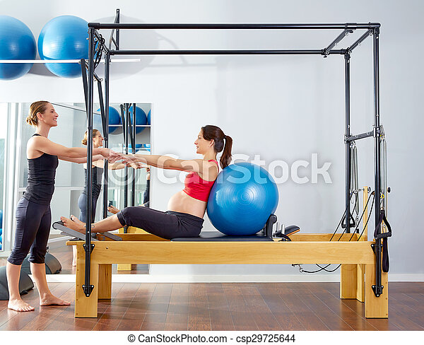 pregnant woman pilates reformer fitball exercise - csp29725644