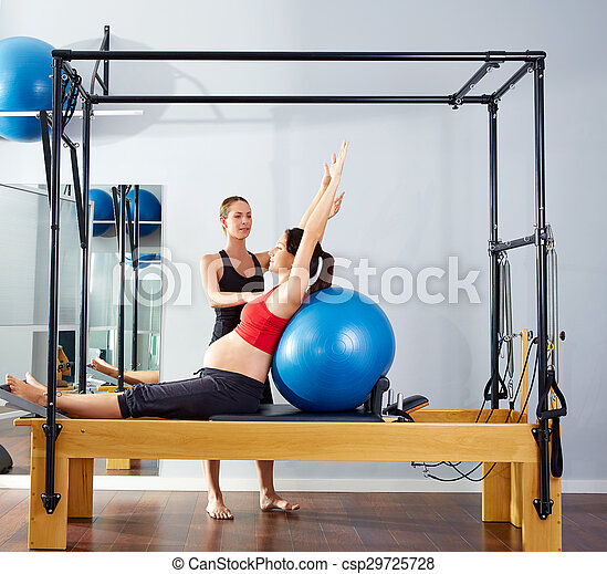 pregnant woman pilates reformer fitball exercise - csp29725728