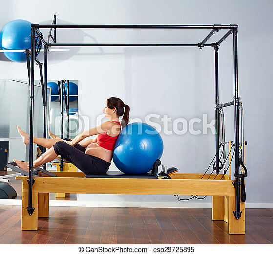 pregnant woman pilates reformer fitball exercise - csp29725895