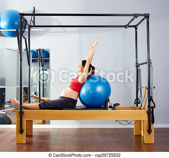 pregnant woman pilates reformer fitball exercise - csp29725832
