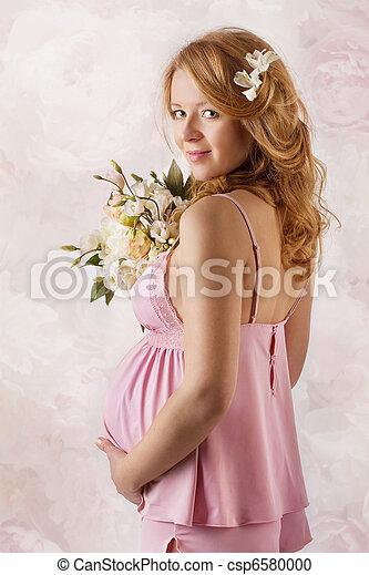 Pregnant woman smiling at camera. - csp6580000
