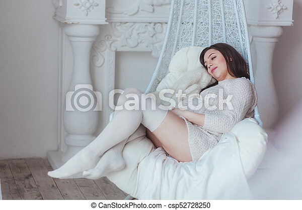 cef0b4f6c Pregnant Woman With Long Brunette Hair Wearing Elegant Lingerie And Socks  In White Fashion Luxury