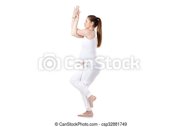 prenatal yoga garudasana full length portrait of young