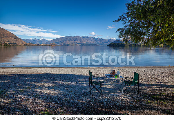 Preparing a breakfast picnic on the shore of Lake Wanaka - csp92012570