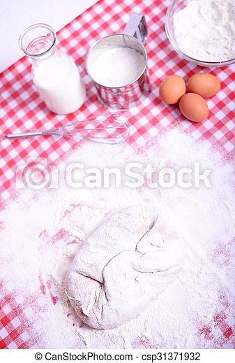 Preparing donuts in kichen table - csp31371932