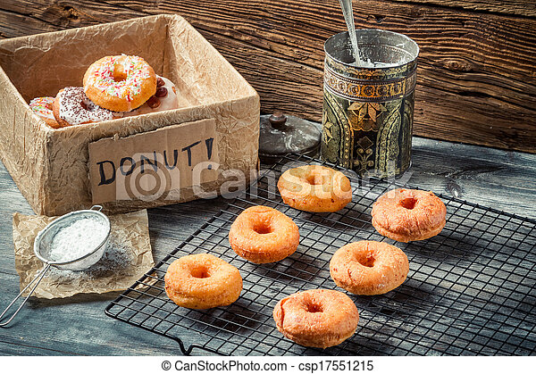 Preparing to decorate donuts with icing sugar - csp17551215