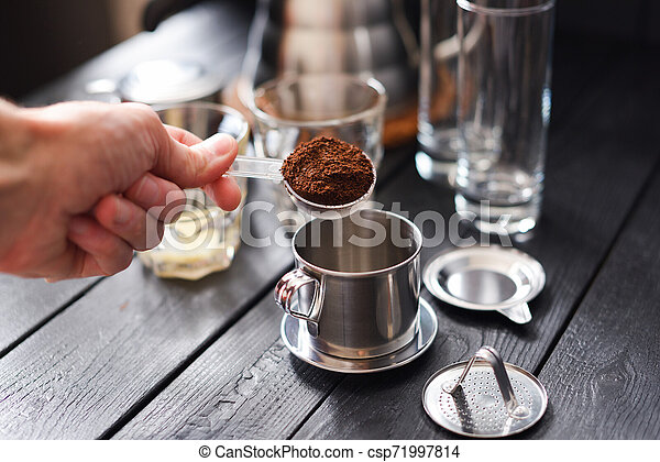 Preraring Drip Coffee Vietnamese Style Man Hand Pouring Ground Coffee Into Metal Coffee Maker Phin On Black Background
