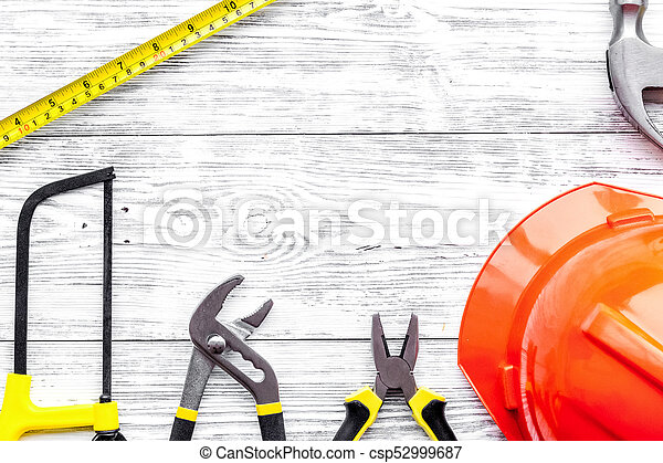 Preraring for home repair. Contruction tools on grey wooden desk - csp52999687
