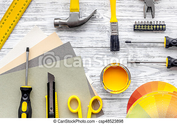 Preraring for home repair. Tools on grey wooden desk background top view copyspace - csp48523898