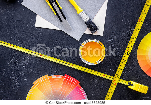 Preraring for home repair. Tools on balck stone desk background top view - csp48523985