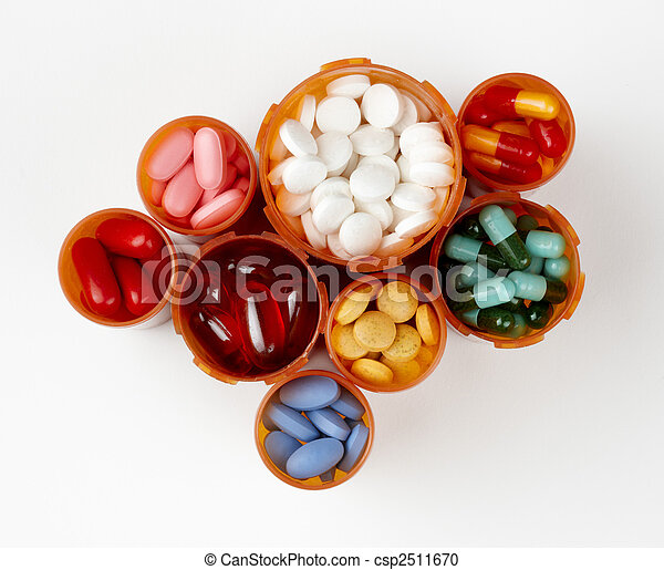 Prescription bottles filled with colorful medications - csp2511670