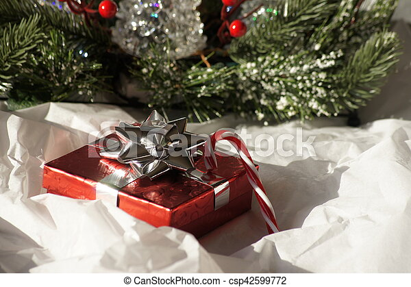 Present and candy cane. - csp42599772