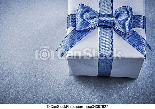 Present box on blue background close up view - csp34387927