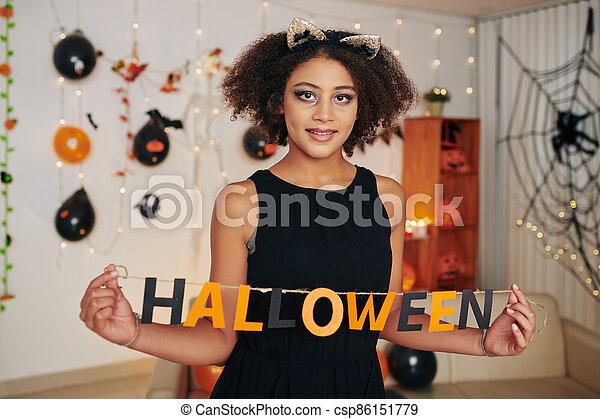 Preteen girl with Halloween letters - csp86151779