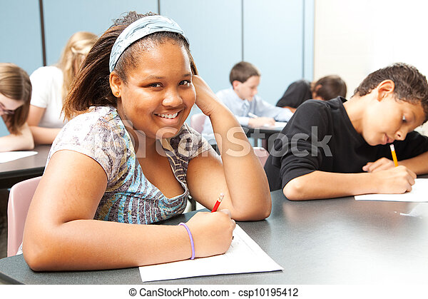 Pretty African-American Teen in Class - csp10195412