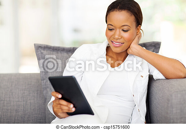 pretty african woman using tablet computer - csp15751600