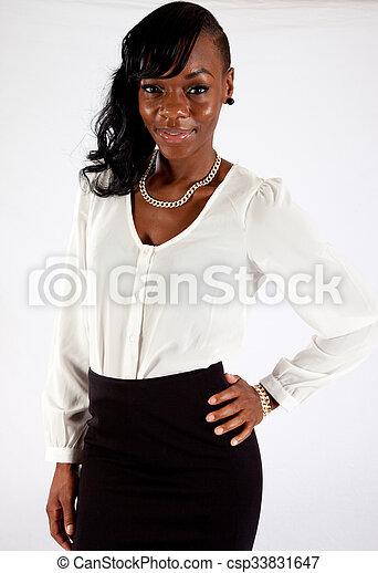 Pretty black woman in white blouse - csp33831647