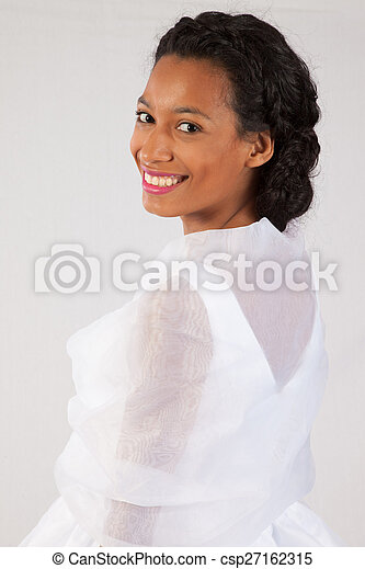 Pretty black woman in white dress - csp27162315