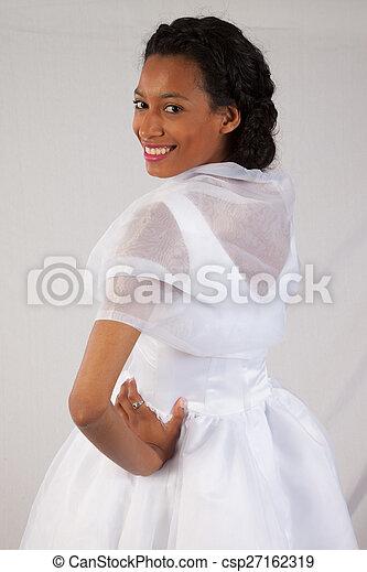 Pretty black woman in white dress - csp27162319