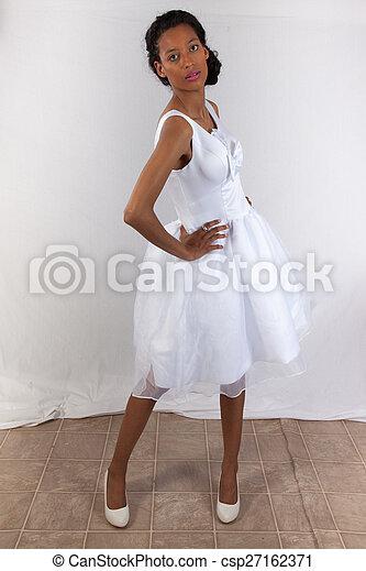 Pretty black woman in white dress - csp27162371