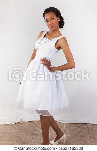 Pretty black woman in white dress - csp27162380
