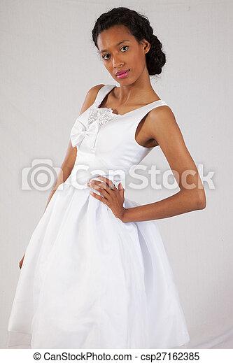 Pretty black woman in white dress - csp27162385